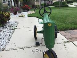 Original antique John Deere pedal tractor #130. Great condition. All original