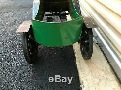 VINTAGE 1950's CIRCA GARTON TIN LIZZIE PEDAL CAR WITH GREEN YELLOW & BLACK PAINT