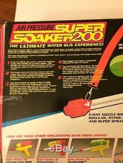 Vintage Larami 1990 Super Soaker 200 Squirt Water Gun w Shoulder Strap Brand New