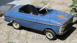 Vintage old rare metal pedal car Moskvich from Russia